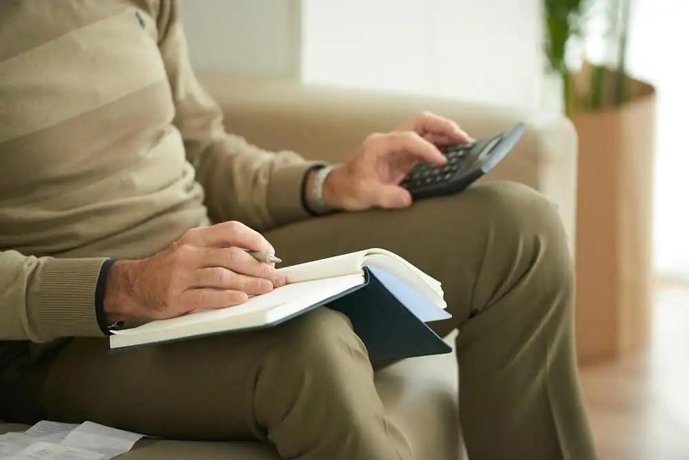 person calculating 401k split in a divorce