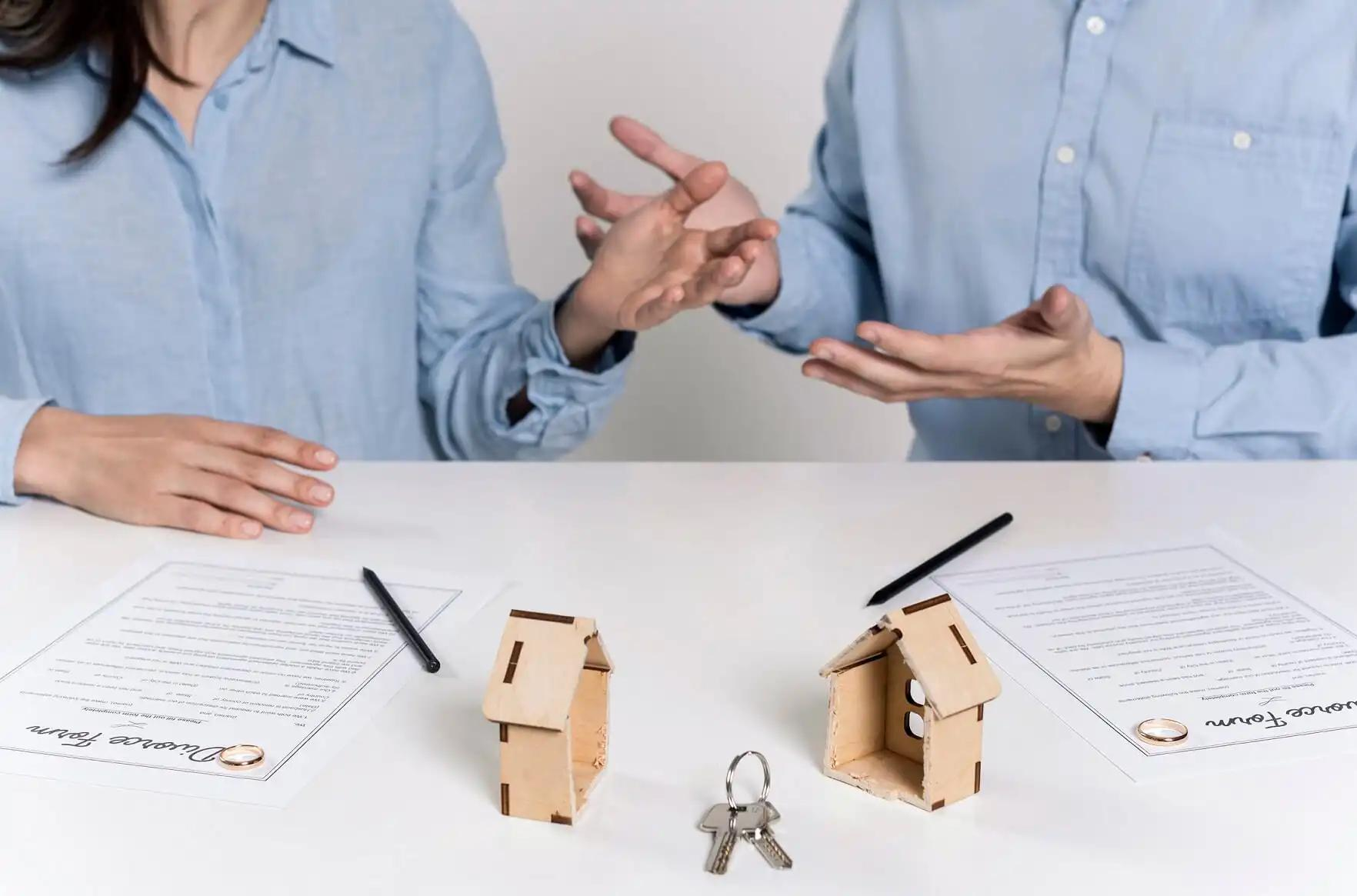 spouses negotiating a divorce agreement