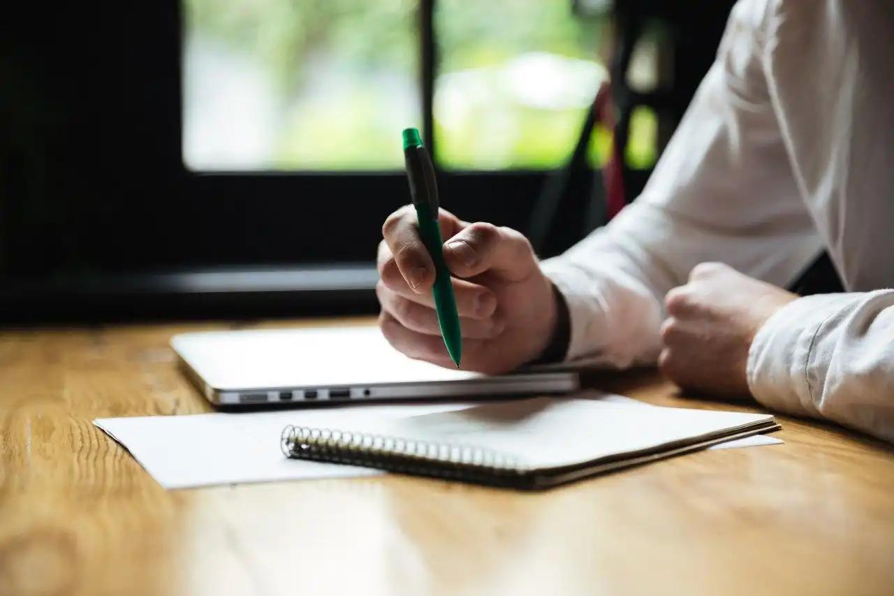 a person writing a divorce checklist